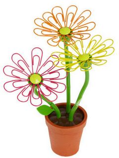 paper clip and brad flowers.  so cute!: