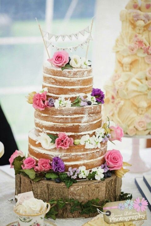 Love this simple naked wedding cake love the wooden log/board underneath - cake topper available from www.theweddingofmydreams.co.uk