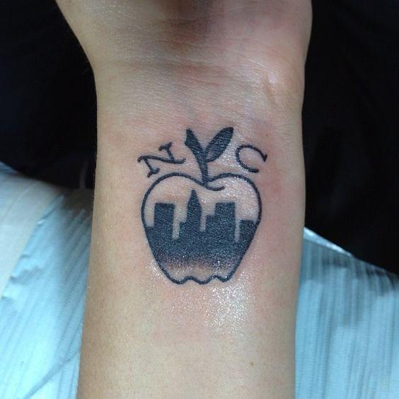 Newyork City Apple Tattoo Design On Wrist Ideas And Designs Apple Tattoo New York Tattoo Nyc Tattoo