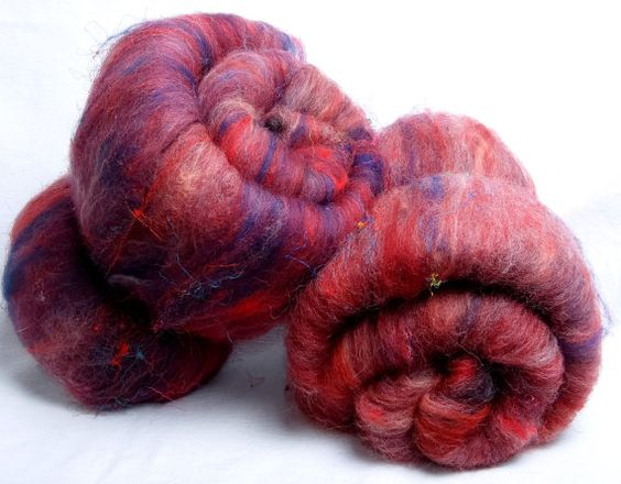 These have no sparkle and are smooth except for tiny strands of sari silk  Spinning batts 113g Silk Merino Polwarth sari silk by YummyYarnsUK, £12.99