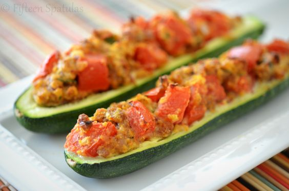 Zucchini stuffed with Italian Sausage, tomatoes, parmesan, bread crumbs, and herbs. Quick to put together and totally delicious!