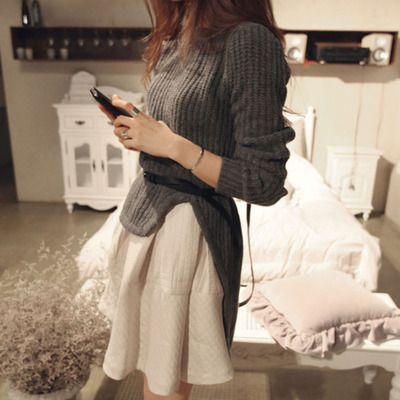 Price:$39.99 Color: Dark Gray Material: Acrylic Blends Stylish elegant solid color cropped high-low knit sweater