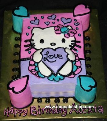 This childs Hello Kitty birthday cake features a hand-drawn Hello Kitty holding a heart. Hearts also decorate the background and the four corners. It is iced in buttercream. See below for a version done in rolled fondant.