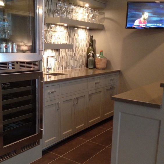 Cool basement bar with mini fridge and corian counter Wet bar images