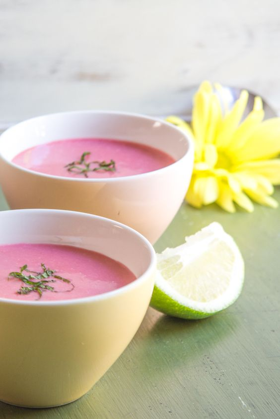 Strawberry soup with coconut milk, lime juice, and finished with slivers of fresh mint. Perfect appetizer soup for a summer party.
