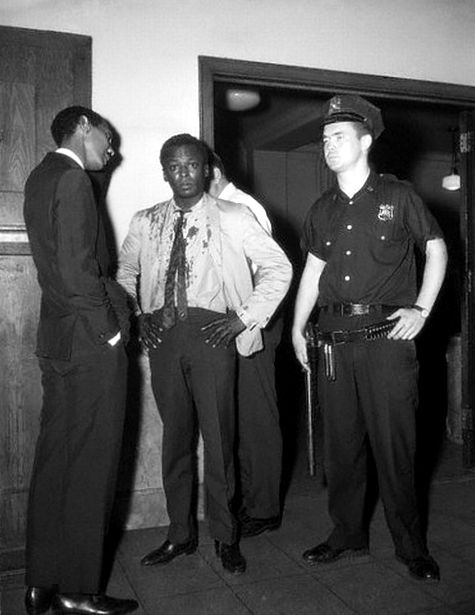 """Miles Davis was standing outside Birdland where he just performed and was taking a break. Police saw him escort a white female friend from the club into a taxi and then they approached him after as he was taking a smoke break. The cops told him to """"move on"""". Miles said he was playing at the club and was on break. They weren't hearing any of that. One cop then punched him in the stomach, while another one cracked him on the head with a nightstick."""