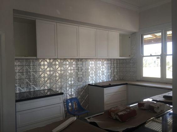 Installation of pressed tin to kitchen area