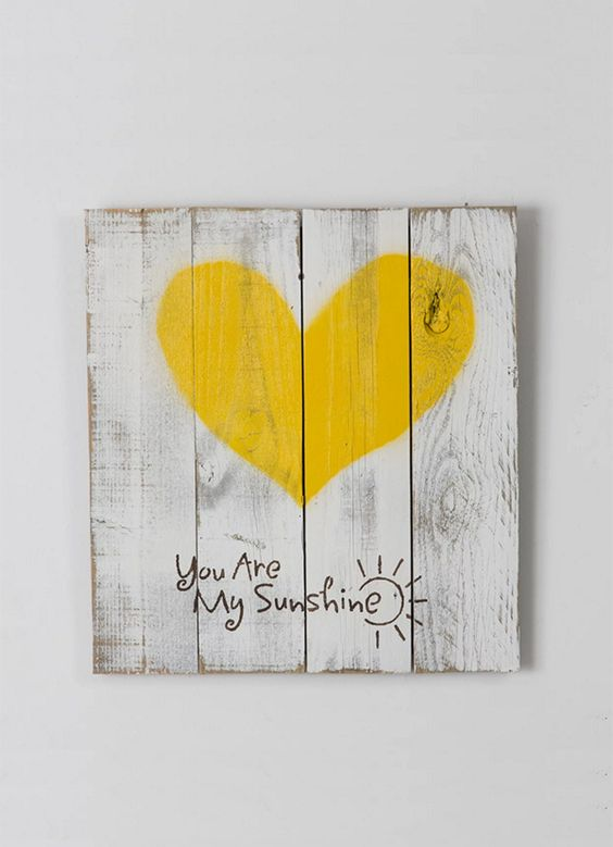 "Lighten up your home with this super cute sign! This sign is made 100% out of reclaimed wood and features a happy yellow heart with the phrase ""You Are My Sunshine"" and a stylized sun on a shabby chic white background. We use old fence wood to create each beautiful piece. The item is handmade in the USA. #LGLimitlessDesign #Contest"