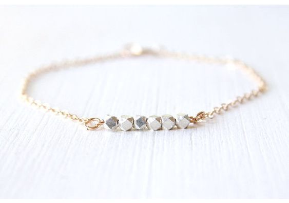 silver and gold bracelet:
