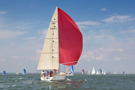 The Beneteau First 40.7 yacht 'Rocket Dog' racing during Cowes Week 2013.