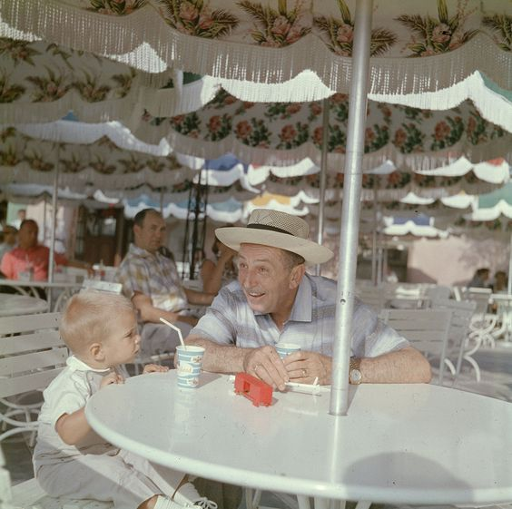 Walt and his grandson taking a break and enjoying some soft drinks in Frontierland. | 18 Wonderful And Rare Color Photos Of Disneyland In 1955: