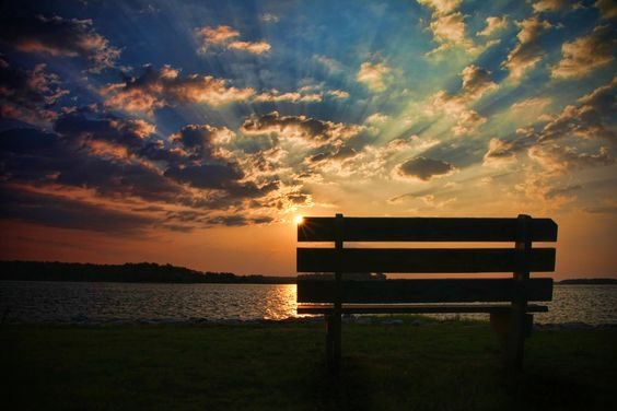 Beautiful sunrise in a perfect place. So want to be seated on that bench!