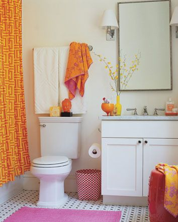 Brightly colored accessories bring an otherwise bland bathroom to life.