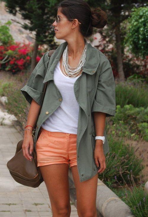 Army green jacket, white tank, orange shorts, white watch, layered necklaces.