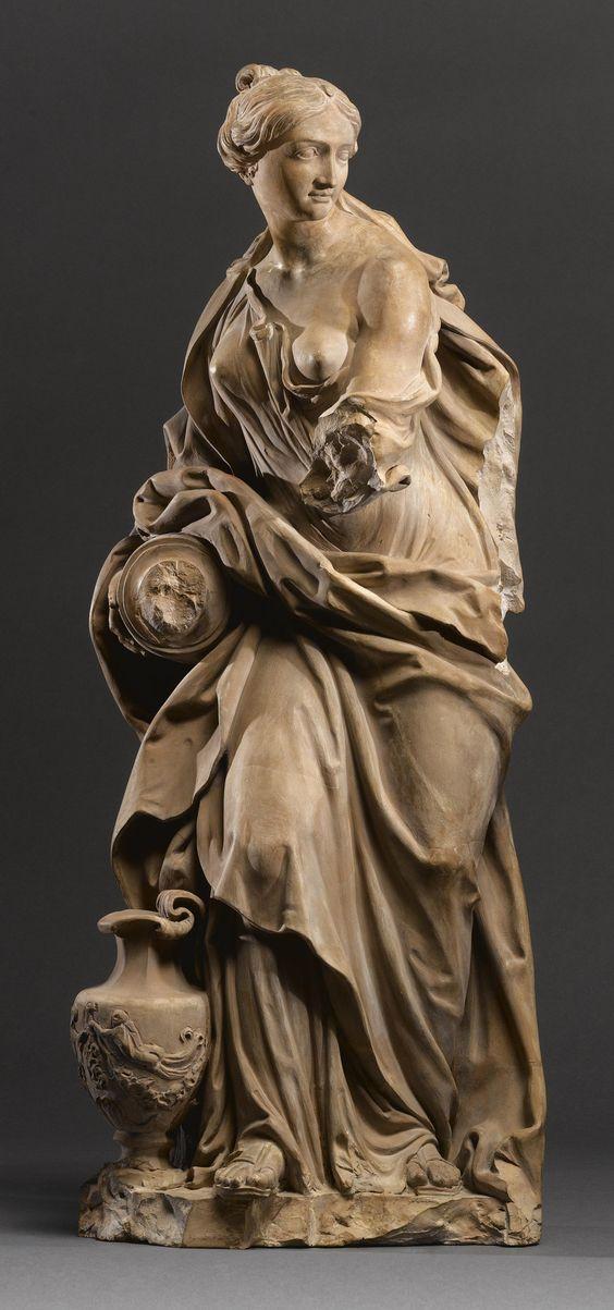 An Italian terracotta allegorical figure of Temperance, by Filippo Della Valle (1698-1768), first half 18th century.