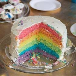 Rainbow layer cake - a stunning party or birthday cake for the little ones! You'll score loads of ooohs and aahs with this recipe!