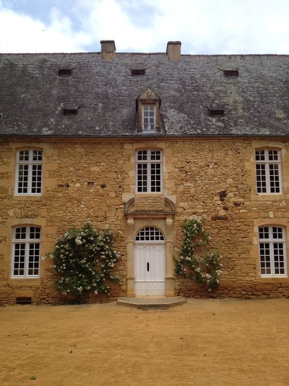 French houses, French charm and Roses. The stonework has rustic wonder!