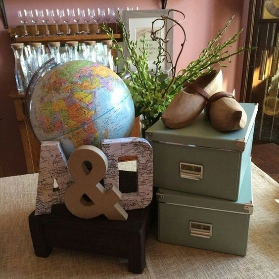 Globe and wooden shoes at a Vintage Travel BridaL Shower Party! See more party ideas at CatchMyParty.com!