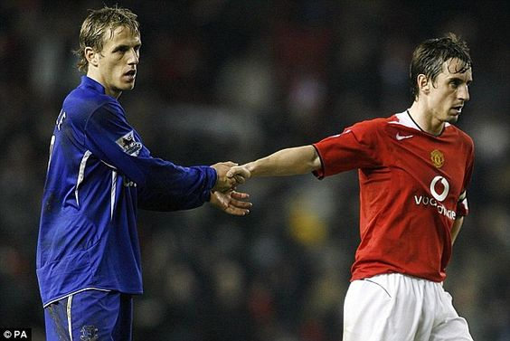 Brotherly love: United's Gary Neville (right) shakes hands with Everton's Phil Neville