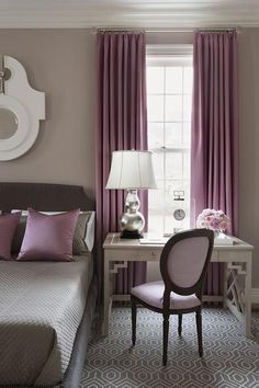 Gray and Purple bedroom features walls painted warm gray lined with a gray bed dressed in gray bedding and purple pillows next to a gray desk as nightstand and purple round back topped with a silver double gourd lamp.