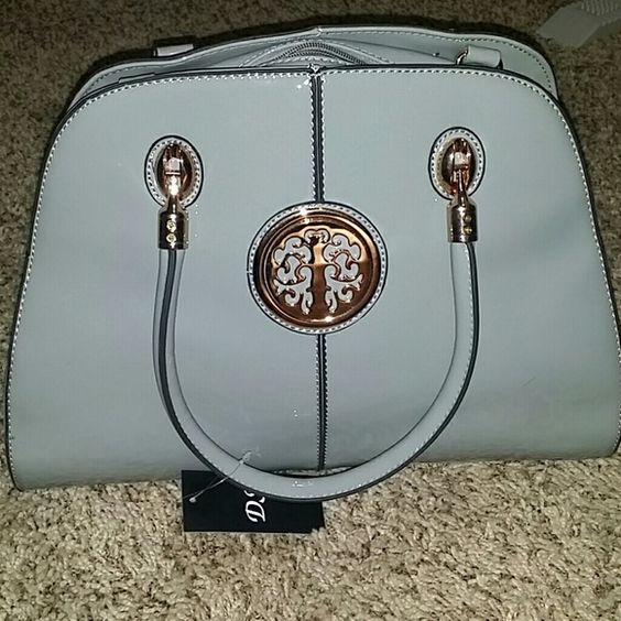 Cute grey/taupe NWT purse Never been used-still has original packing inside and strap. Very cute handbag! Bags