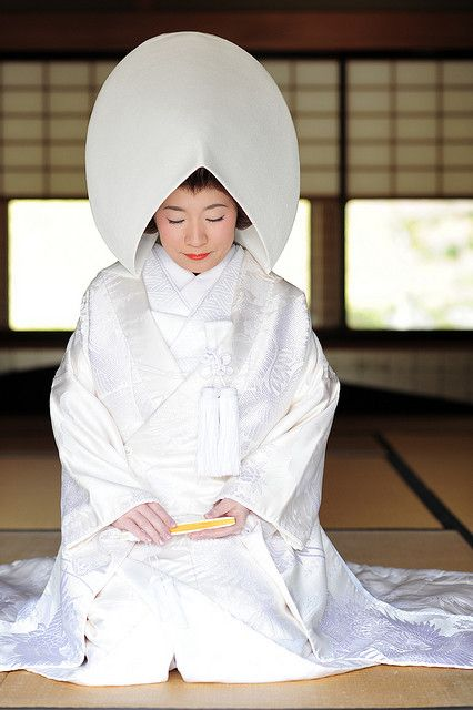 Japan  The bride wears a shiromuku, a white wedding kimono.