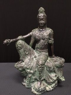 1991 AUSTIN SCULPTURE 21X15 INCH HEAVY WORK OF ART OF KUAN YIN, THE GODDESS OF MERCY. THIS SCULPTURE HAS A WONDERFUL PATINATED FINISH AND DISPLAYS WELL BUT THERE ARE A FEW CHIPS AND LOSS TO HER FINGERS.