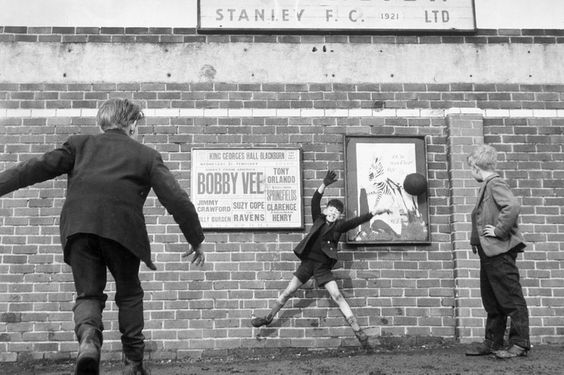 Accrington Stanley. No more football inside the ground so three youngsters play outside. 6th March 1962.