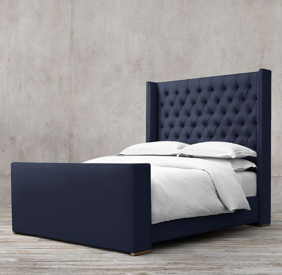 ordered for master Adler Tufted Fabric Platform Bed With Footboard