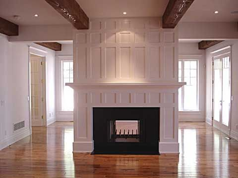 Wainscoted fireplace.: