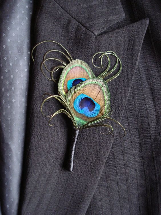 This simple elegant peacock feather boutonniere is dressed with beautiful peacock curls and a simple black satin wrap. Perfect for your peacock themed: