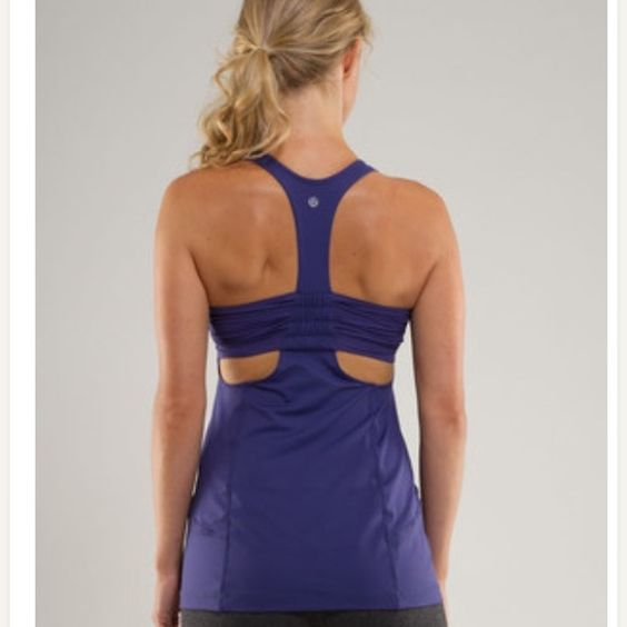 Lululemon purple turbo tank! Excellent used condition, no damage, stains or pulls. This style has a built in shelf bra. lululemon athletica Tops Tank Tops