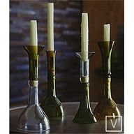 old wine bottle tops connected by the corks to make unique candle holders! http://media-cache4.pinterest.com/upload/178314466465982702_wEJWRE4e_f.jpg ashaynew good ideas