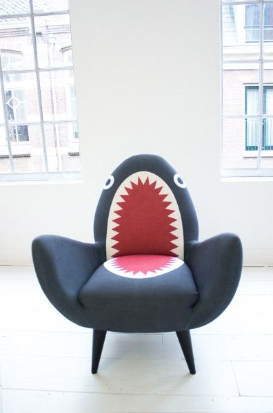Eline's Rodnik Shark Fin Chair making a statement combined with her white floorboards and white walls. Jawsome. | MADE.COM/Unboxed