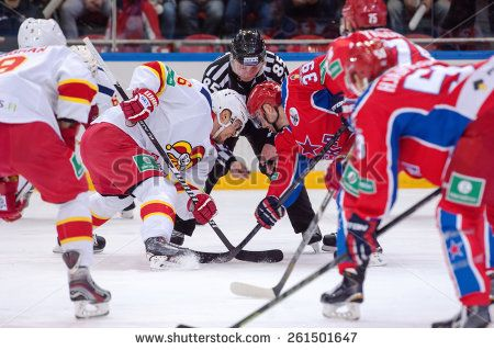 MOSCOW - MARCH 12: P. Virtanen (26) and J. Murshak (74) on faceoff on hockey game Yokerit vs CSKA on Russia KHL championship on March 12, 2015, in Moscow, Russia. CSKA won 3:2 http://www.shutterstock.com/pic.mhtml?id=261501647  #action, #active, #arena, #competition, #continental, #cska, #defender, #faceoff, #game, #helmet, #hockey, #ice, #khl, #kontinental, #league, #men, #moscow, #murshak, #offencive, #rink, #russia, #skate, #sport, #sportsmen, #stadium, #stick, #tournament, #uniform…
