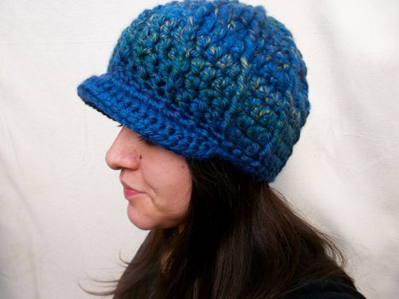 Galaxy Blue, with hints of yellow and green males for a beautifully eye catching newsboy beanie. Not only eye catching but warm and perfect for those cold winter days and nights. crochet newsboy hat crochet newsboy beanie by TigerLilyCreation2
