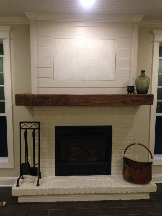 Painted brick wood mantel and shiplap minus the hid a tv grandmothers mirror will look much - Brick fireplace surrounds ideas ...
