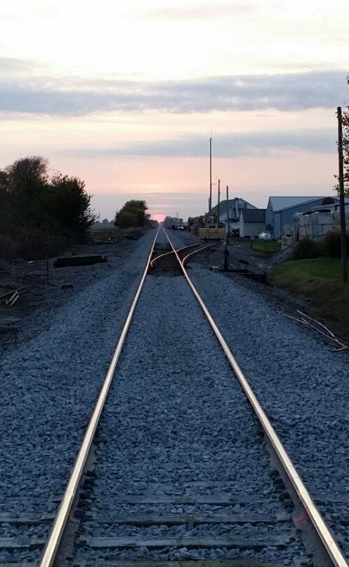 Railroad track at sunset by Patrick Millard.