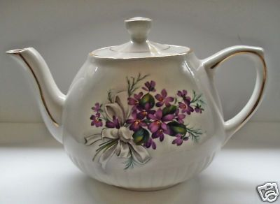 Ellgreave Ironstone teapot in redish-purple hue of violets with a white bow.  Vintage cutie.