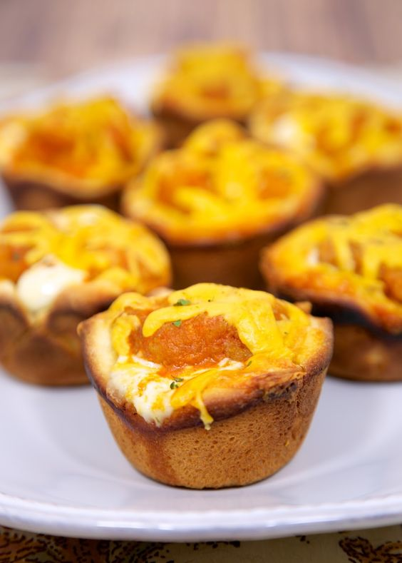Buffalo Chicken Cupcakes - frozen popcorn chicken, buffalo sauce, ranch and cheddar baked in crescent cups - great for lunch, dinner or a party!