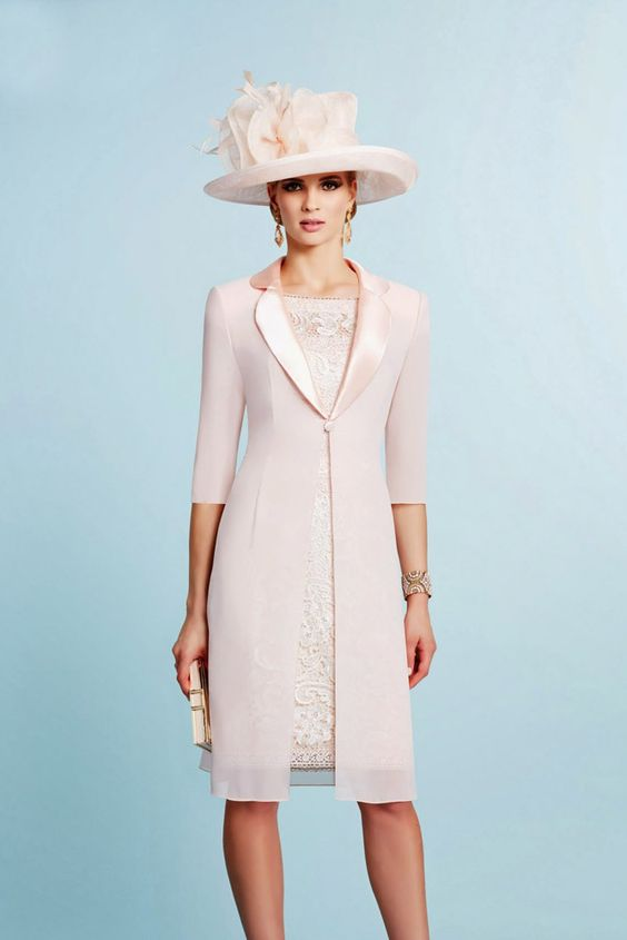Ronald Joyce – 991024 – 01 In a soft Pale Pink, this fabulous lace shift dress is delicate yet chic and very elegant. The dress is knee length. It also has a nice high rounded neckline and pretty capped sleeves. Read More...