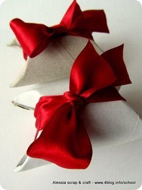 wrap a toilet roll with special paper.  Put small gift inside and bend the ends - tie and bow and you have pretty packaging