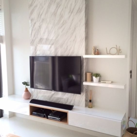 Tv feature wall with a single panel marble backdrop and for Feature wall tile ideas