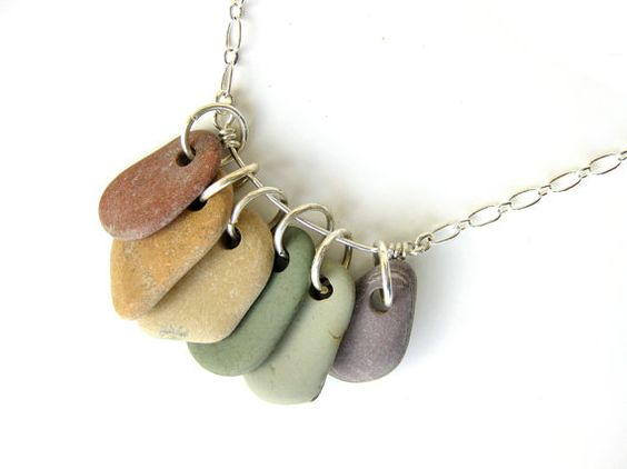 rainbow of natural, undyed pebbles (in a necklace that I made!)