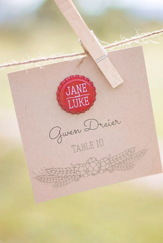 Custom bottle tops used for wedding decor and place cards.