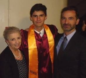 me, grandson, son at grandson's  high school graduation.