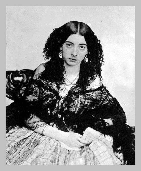 "Eliza Rosanna Gilbert, better known by her stagename Lola Montez. Known for her risque ""spider dance"". While performing in St. Louis at The Varieties Theatre in March 1853, she got into an argument with the manager, breaking his nose with a candlestick.Photo from the S F City Guides, Bruce Seymor:"