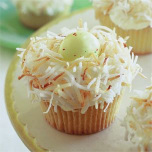 """Easter Egg Nest Cupcakes.  From the Food Channel:  """"Toasting the coconut that forms the nests adds a natural straw color as well as a pleasant crunch and nutty flavor to these whimsical cupcakes. Easter egg candies come in many different sizes; use as many as will comfortably fit in each nest.  This recipe courtesy of Williams-Sonoma."""""""