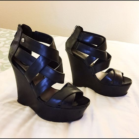G By Guess Hepbern Wedges GUC G by Guess 5in Black Strap wedges with zip up back. I would say these wedges are in pretty good shape with the exception of the wear on the bottom of the heel. This is not noticeable when on. Please review the pictures and ask any questions. Offers considered through offer tab. Added discount when you bundle. G by Guess Shoes Wedges