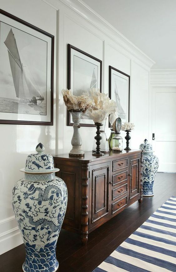 Beautiful China vases frame the chest and the framed pictures on the wall